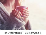 Hands Holding Hot Cup Of Coffe...