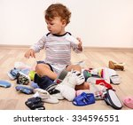 toddler playing with a lot of... | Shutterstock . vector #334596551