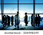 Businessmen Handshake Deal...