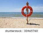 Life Buoy On A Beach Against...