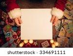 Santa Claus Holding A Blank...