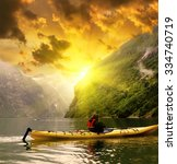 kayaker takes a photo of... | Shutterstock . vector #334740719
