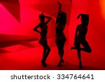 silhouettes of three slim...