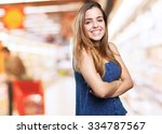 young woman smiling over white... | Shutterstock . vector #334787567