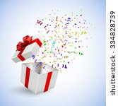 gift box with confetti on a... | Shutterstock .eps vector #334828739