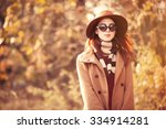 Woman In Coat With Hat And...