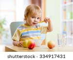 cute child eating healthy food... | Shutterstock . vector #334917431