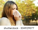 young girl with allergy in... | Shutterstock . vector #334929077