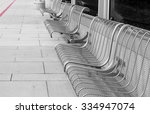 Row Of Empty Seats At Bus Stop. ...
