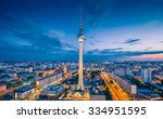 Stock photo aerial view of berlin skyline with famous tv tower at alexanderplatz and dramatic clouds in 334951595