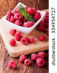 raspberries on a white... | Shutterstock . vector #334954727