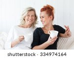 two beautiful women a mother... | Shutterstock . vector #334974164