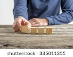 front view of male hand placing ...   Shutterstock . vector #335011355