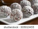 homemade coconut rum balls on... | Shutterstock . vector #335013455