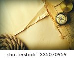 antique brass compass and rope... | Shutterstock . vector #335070959