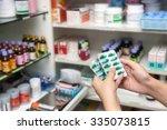 hand holding remedy. medicine.   Shutterstock . vector #335073815