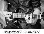 Male Musician Playing On Guitar ...