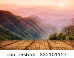 table wood textured on blurred... | Shutterstock . vector #335101127