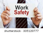 work safety. man holding a card ... | Shutterstock . vector #335120777