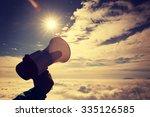 hand hold loudspeaker to sky on ... | Shutterstock . vector #335126585