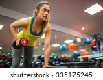 woman doing a workout with... | Shutterstock . vector #335175245