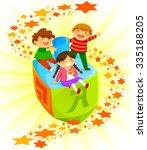 happy kids riding a big dreidel ... | Shutterstock .eps vector #335188205