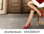 long slim woman legs and red... | Shutterstock . vector #335200019