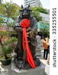 Small photo of Hong Kong, China - October 3, 2015: Chinese Zodiac Bronze Ox Stature at Sik Sik Yuen Wong Tai Sin Temple