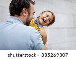 father holding his son | Shutterstock . vector #335269307
