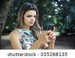 beautiful girl using a mobile... | Shutterstock . vector #335288135