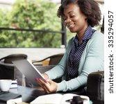 african woman using tablet... | Shutterstock . vector #335294057