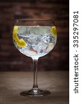 gin and tonic on a wooden table ... | Shutterstock . vector #335297081