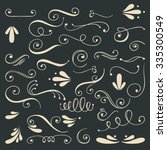 set of hand drawn swirls.... | Shutterstock .eps vector #335300549