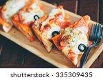 ham cheese toast on wooden... | Shutterstock . vector #335309435