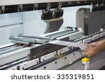 Operator Bending Metal Sheet B...