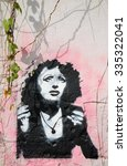 "Small photo of LISBON, PORTUGAL - APRIL 23, 2015: Graffiti portrait of Fado singer Amalia Rodrigues, known as ""Queen of Fado""."