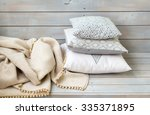 cushions and plaid on the white ...   Shutterstock . vector #335371895