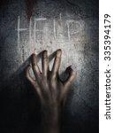 horror scene. hand on wall... | Shutterstock . vector #335394179