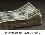 stack of one hundred dollar... | Shutterstock . vector #335397047
