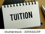Tuition memo written on a notebook with pen - stock photo