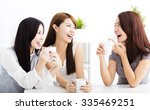 three happy young woman... | Shutterstock . vector #335469251