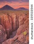 a narrow canyon with a volcano...   Shutterstock . vector #335533544