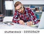 web designer creating layout... | Shutterstock . vector #335535629