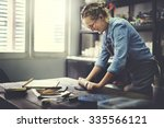 woman rolling clay craftsman... | Shutterstock . vector #335566121