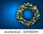 blue card with christmas wreath.... | Shutterstock .eps vector #335580095