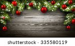 christmas wooden background... | Shutterstock .eps vector #335580119