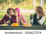 two girls talking in secret...   Shutterstock . vector #335627279