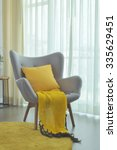 yellow scarf and yellow pillow... | Shutterstock . vector #335629451