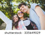 happy teenage friends smiling... | Shutterstock . vector #335649029