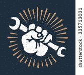 vector spanner in hand emblem ... | Shutterstock .eps vector #335713031